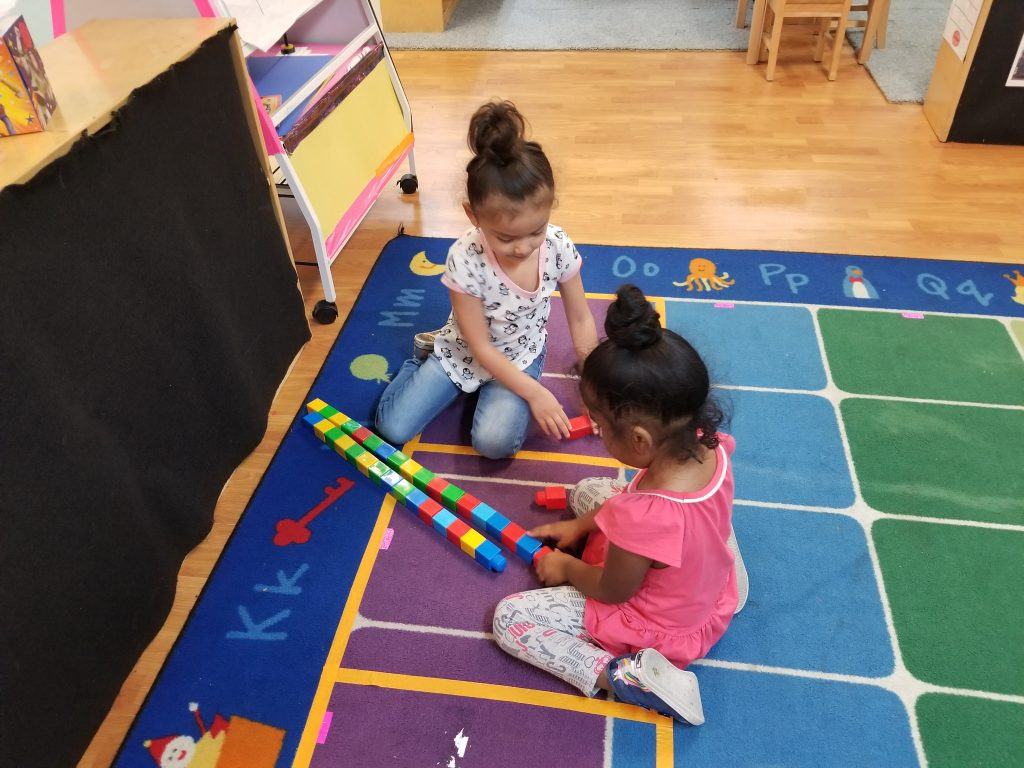 Hutto Head Start children play with blocks